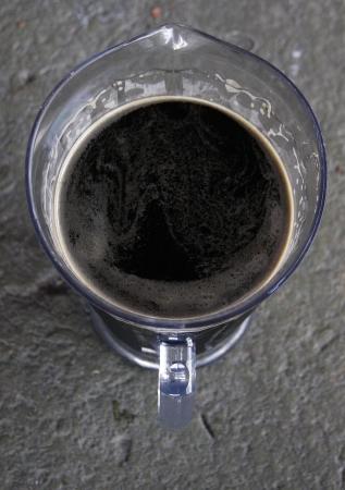 A pitcher of dark beer