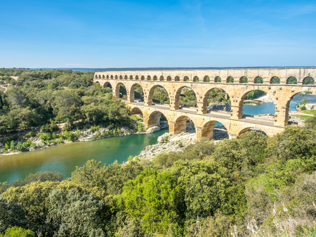 Pont du Gard, ancient Roman aqueduct, crosses Gardon river, indicates intelligent of Roman enginerring, located in Nimes, France