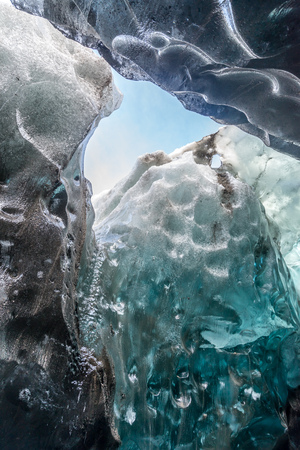 Ice cave located beneath glacier among ice mountain in Iceland, it is mesmerizing landmark.