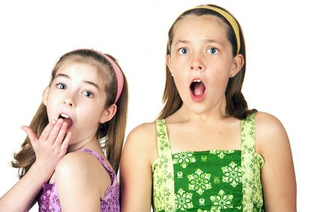 Two cute little girls with a surprised look on their faces