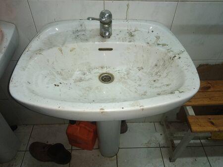 Foto de Old disgusting dirty colourful drain in ancient industry - Imagen libre de derechos