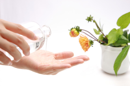Applying skin lotion to hands