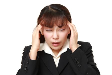 businesswoman suffers from headache