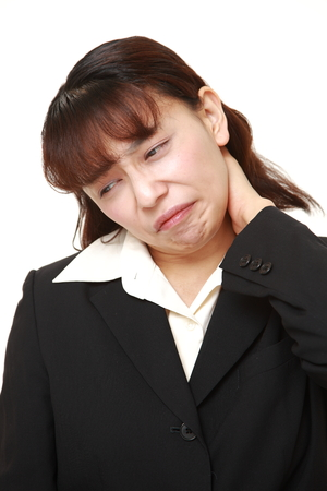 asian businesswoman suffers from neck ache