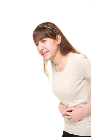 young woman suffers from stomachache