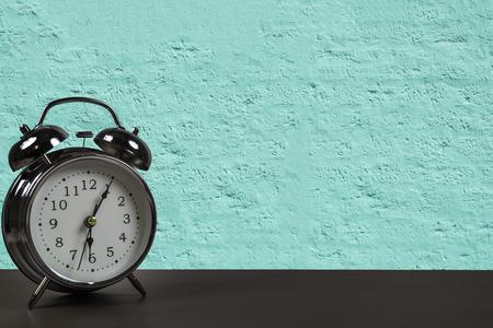 Foto de Retro alarm clock on a desk. - Imagen libre de derechos
