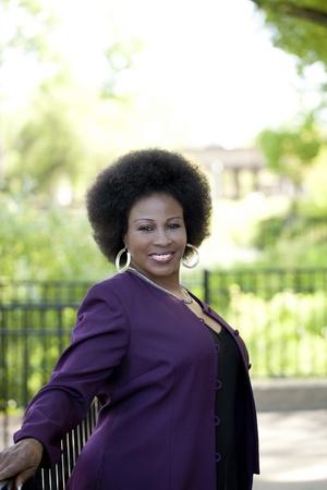 Foto für Middle-Aged Black woman outdoor portrait purple jacket black dress - Lizenzfreies Bild