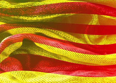 Waved Catalonia flag. Grunge distress texture. Denim fabric