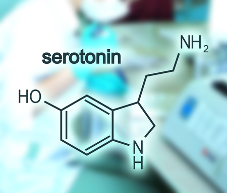 Foto de Chemical molecular formula hormone serotonin. Blurred backdrop with young female doctor - Imagen libre de derechos