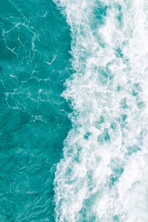 Turquoise olive green ocean wave during summer tide, abstract sea nature background