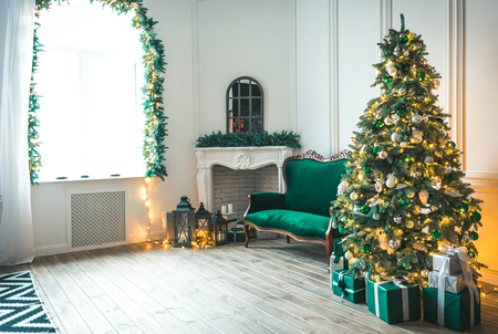 Photo for Christmas living room with a fireplace, sofa, Christmas tree and gifts. Beautiful New Year decorated classic home interior. Winter background - Royalty Free Image