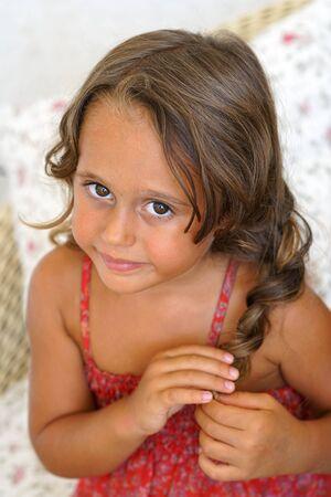 Photo pour Portrait of Cute little girl looking - image libre de droit