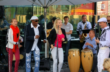 Helsinki, Finland - August 21, 2014 - Members of the Los Salsanismo! group performing salsa music and dance live at the terrace of the Helsinki Music Centre as part of the annual Night of the Arts festival in Helsinki, Finland.