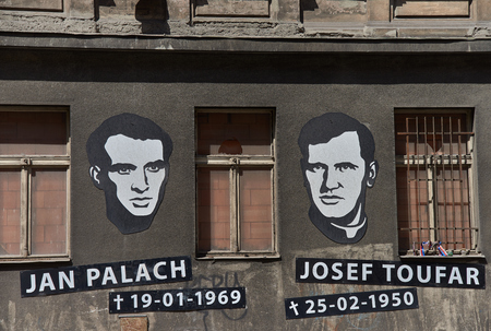 Prague, Czech Republic - July 7, 2017: Portraits and dates of birth and death placed in memory and honor of Jan Palach and Josef Toufar on exterior of a building by the Legerova street in Prague.