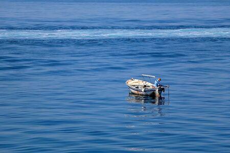 Photo pour Unrecognizable fisherman on a small rustic fishing boat in Croatia. - image libre de droit