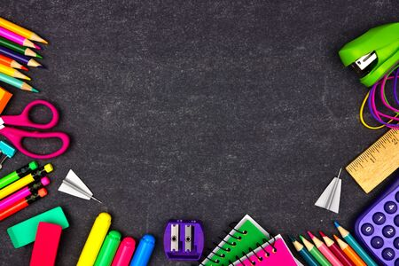 Photo pour School supplies border frame, top view on a chalkboard background with copy space, back to school concept - image libre de droit