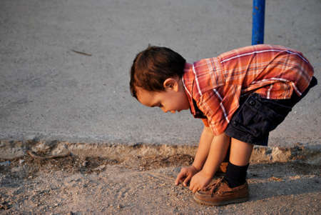 Cute boy bending over, curiosity