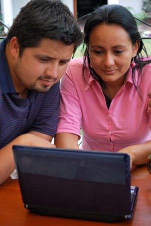 Hispanic couple using the computer