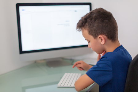 Photo for New media education, kid watching learning lessons on pc. Virtual classroom - Royalty Free Image