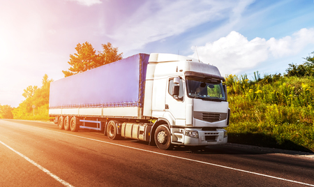 Photo for big white truck on the road in a rural landscape at sunlight. perfect sky. over the asphalt road at sunset. logistics transportation and cargo freight transport industrial business commercial concept - Royalty Free Image