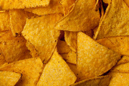 some tortilla chips forming a background pattern
