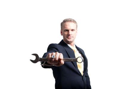 Photo pour a closeup of a young businessman holding a wrench to the camera - image libre de droit