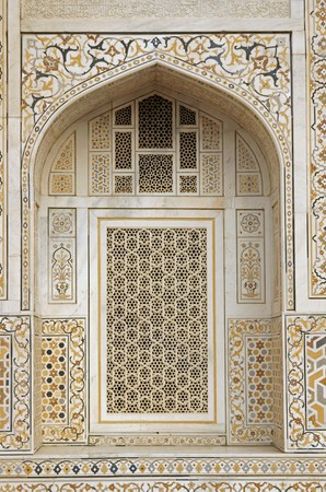 Window arch of the ornate white marble Mughal tomb (I'timad-ud-Daulah). 17th Century AD. Agra, Uttar Pradesh, India