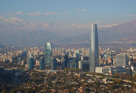 Modern office and apartment blocks of Santiago in Chile against the backdrop of the snow capped mountains of the Andes