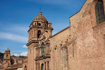 Red granite walls of the historic Iglesia La Merced located close to the Plaza de Armas in Cusco, Peru. The church was founded in 1535 and was constructed shortly after the Spanish conquest of the Inca Empire.