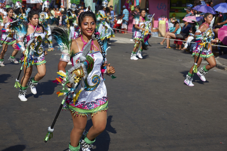ARICA, CHILE - JANUARY 22, 2016: Young woman performing in a Tobas dance group at the Carnaval Andino con la Fuerza del Sol in Arica, Chile. The dance originates in Oruro, Bolivia