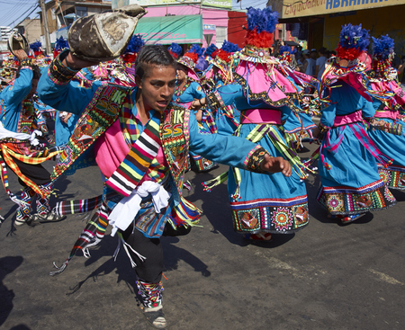 ARICA, CHILE - JANUARY 22, 2016: Tinku dancing group in colourful costumes performing a traditional ritual dance as part of the Carnaval Andino con la Fuerza del Sol in Arica, Chile.