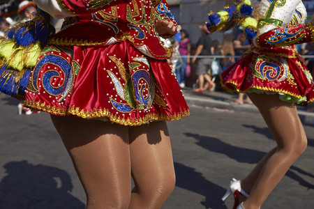 ARICA, CHILE - JANUARY 23, 2016: Detail of the ornate skirts worn by the female members of a Caporales dance group performing at the annual Carnaval Andino con la Fuerza del Sol in Arica, Chile.