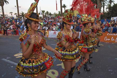 ARICA, CHILE - JANUARY 23, 2016: Morenada dancers in traditional Andean costume performing at the annual Carnaval Andino con la Fuerza del Sol in Arica, Chile.