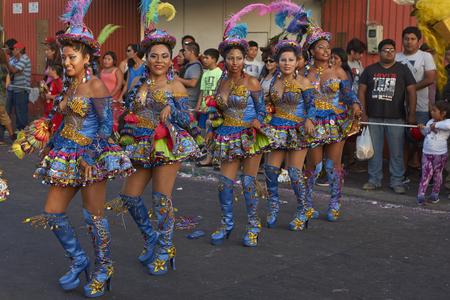 ARICA, CHILE - JANUARY 24, 2016: Morenada dancers in traditional Andean costume performing at the annual Carnaval Andino con la Fuerza del Sol in Arica, Chile.