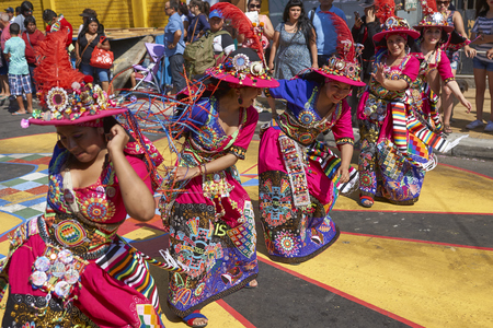 ARICA, CHILE - JANUARY 22, 2016: Tinkus dancing group in colourful costumes performing a traditional ritual dance as part of the Carnaval Andino con la Fuerza del Sol in Arica, Chile.