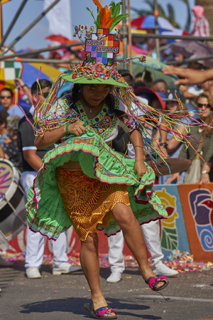 ARICA, CHILE - JANUARY 24, 2016: Tinkus dancing group in colourful costumes performing a traditional ritual dance as part of the Carnaval Andino con la Fuerza del Sol in Arica, Chile.