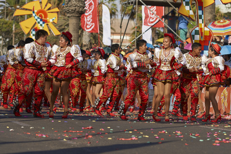 ARICA, CHILE - JANUARY 24, 2016: Caporales dance group in ornate costumes performing at the annual Carnaval Andino con la Fuerza del Sol in Arica, Chile.