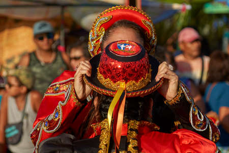 ARICA, CHILE - FEBRUARY 11, 2017: Caporales dance group in ornate costumes performing at the annual Carnaval Andino con la Fuerza del Sol in Arica, Chile.
