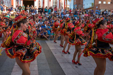 ARICA, CHILE - FEBRUARY 11, 2017: Female members of a Caporales dance group in ornate costumes performing at the annual Carnaval Andino con la Fuerza del Sol in Arica, Chile.