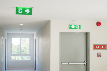 Photo for Fire exit sign with light on the path way in the hotel or office - Royalty Free Image