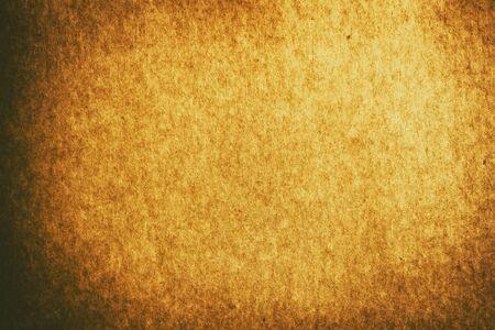 Foto de Full frame old gold brown paper texture background with vignette for design backdrop or overlay design - Imagen libre de derechos