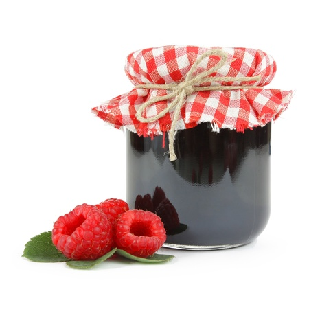 Jam in a jar with fresh raspberries, isolated on white
