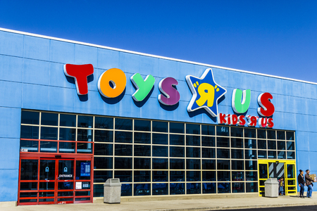 Muncie - Circa March 2017: Toys R Us Retail Strip Mall Location. Toys R Us is a Children's Toy Retailer III
