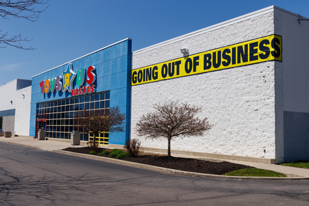Muncie - Circa April 2018: Toys R Us Retail Strip Mall Location. Toys R Us is going out of business after filing bankruptcy I