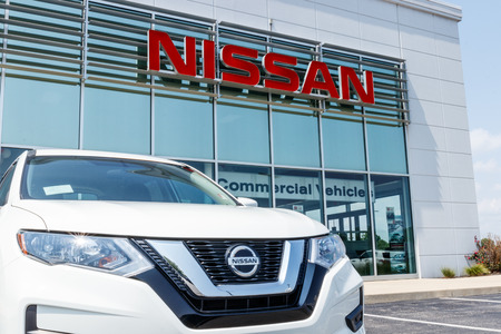 Photo pour Fishers - Circa August 2018: New vehicles at a Nissan Car and SUV Dealership. Nissan is part of the Renault–Nissan Alliance VII - image libre de droit