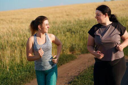 Photo pour fit woman motivate her friend at outdoor jogging - image libre de droit