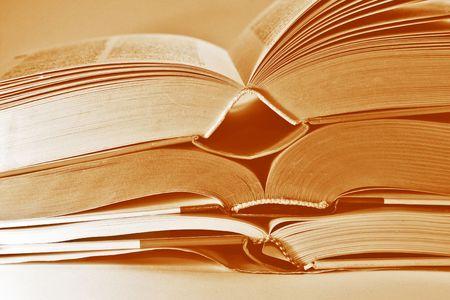 Close-up of three book bindings, tinted photo