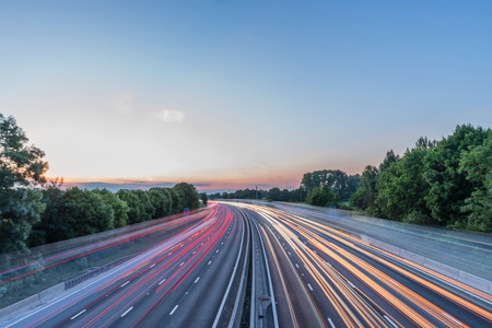 Photo for Sunset view heavy traffic moving at speed on UK motorway in England - Royalty Free Image