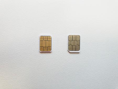 Photo pour two micro sim cards on a light background surface - image libre de droit