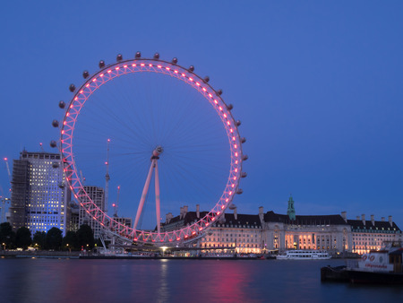 LONDON, UK - JULY 31: A view of the London Eye, County Hall and the River Thames on July 31, 2017 in London, UK. The London Eye is a massively popular tourist attraction.